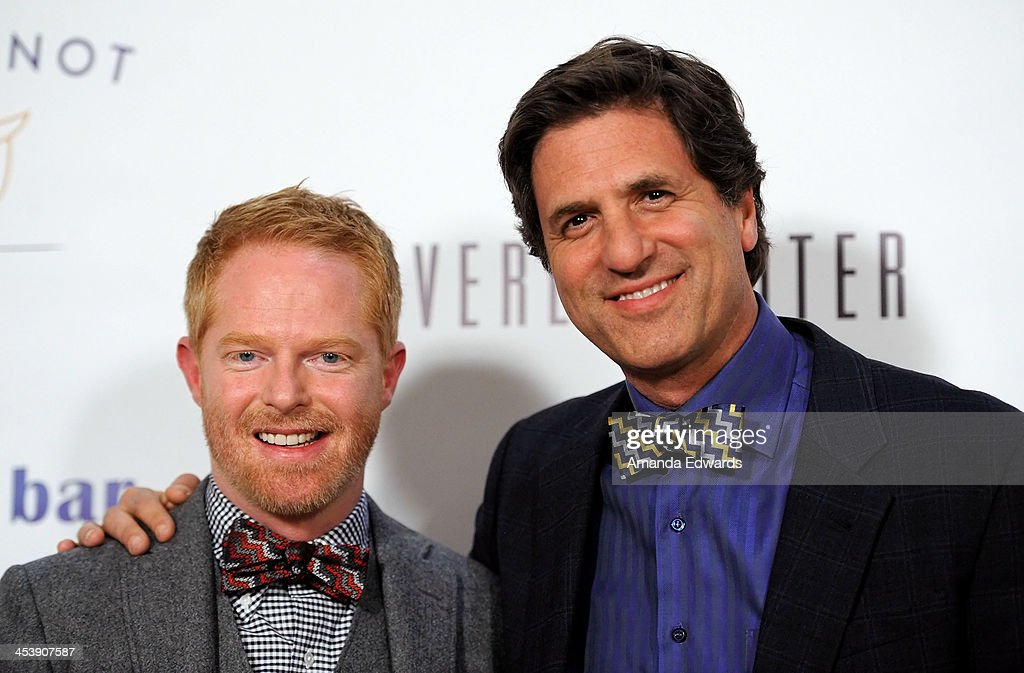 Actor Jesse Tyler Ferguson (L) and Producer Steven Levitan arrive at the 'Tie The Knot' grand store opening at The Beverly Center on December 5, 2013 in Los Angeles, California.