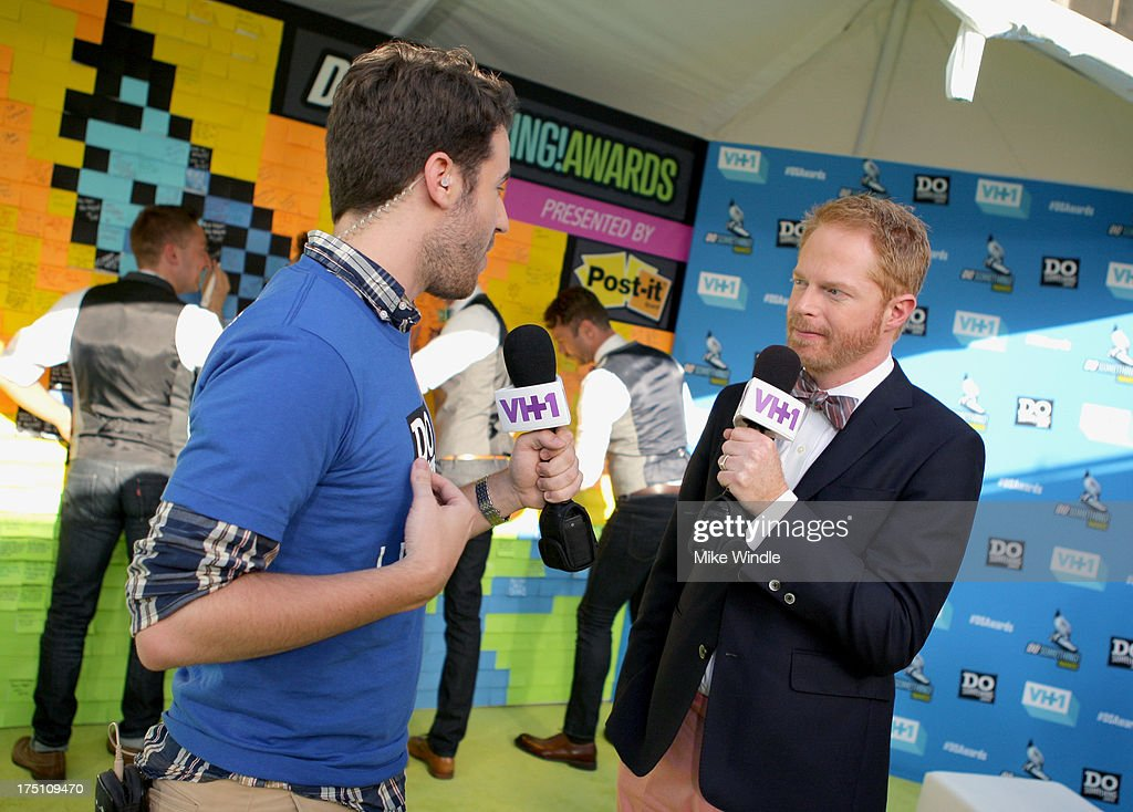 Actor <a gi-track='captionPersonalityLinkClicked' href=/galleries/search?phrase=Jesse+Tyler+Ferguson&family=editorial&specificpeople=633114 ng-click='$event.stopPropagation()'>Jesse Tyler Ferguson</a> (R) launches Post-it Brand Dreams for Good Contest at the DoSomething.org and VH1's 2013 Do Something Awards at Avalon on July 31, 2013 in Hollywood, California.
