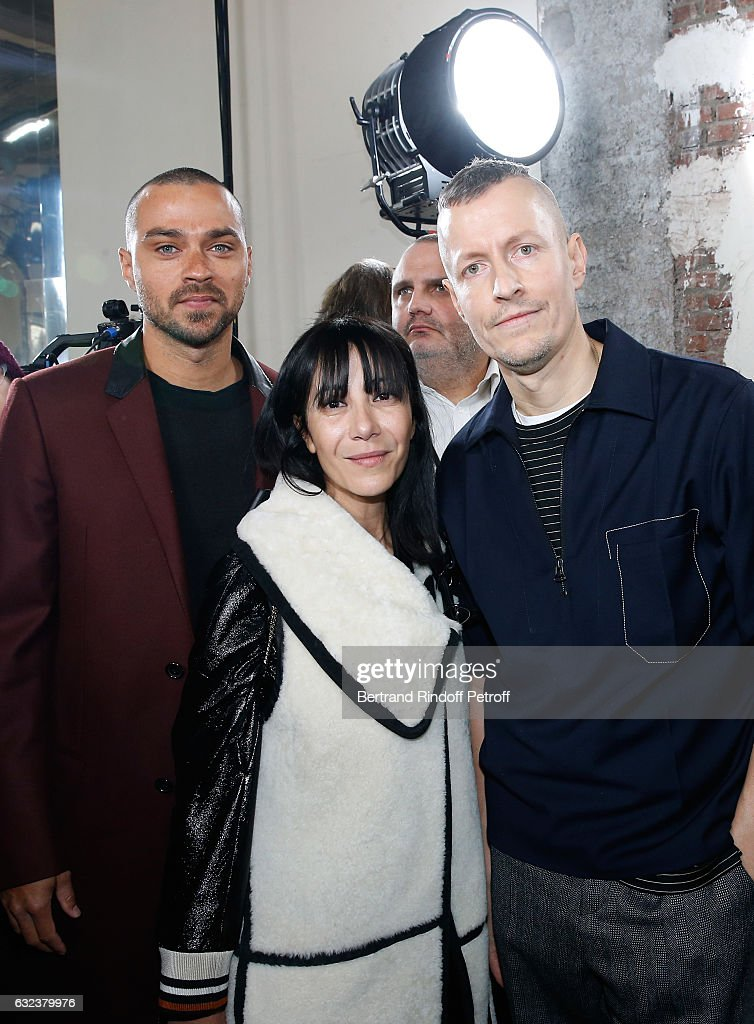 Actor Jesse Williams, Artistic Director and Stylist of Lanvin Women, Bouchra Jarrar and Stylist of 'Lanvin Men', Lucas Ossendrijver attend the Lanvin Menswear Fall/Winter 2017-2018 show as part of Paris Fashion Week on January 22, 2017 in Paris, France.