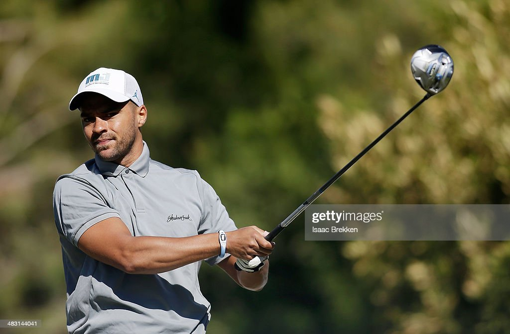 Actor Jesse Williams hits a tee shot during Aria Resort & Casino's 13th Annual Michael Jordan Celebrity Invitational at Shadow Creek on April 6, 2014 in North Las Vegas, Nevada.