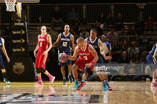 Actor Jesse Williams of the West Team drives against the East Team during the Sprint NBA AllStar Celebrity Game 2014 at Sprint Arena during the 2014...