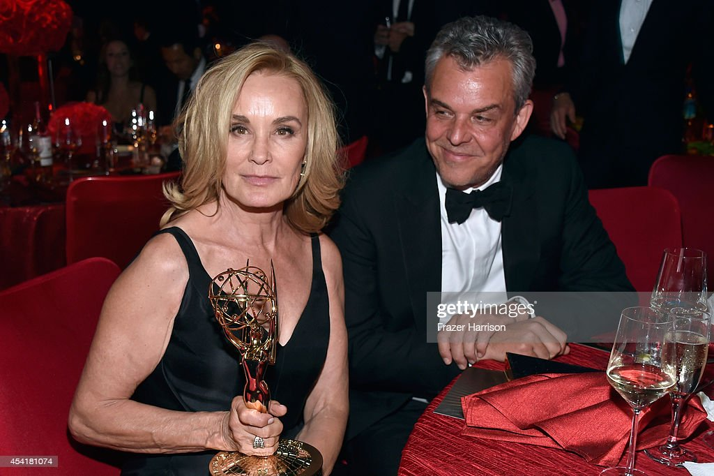 Actor <a gi-track='captionPersonalityLinkClicked' href=/galleries/search?phrase=Jessica+Lange&family=editorial&specificpeople=203310 ng-click='$event.stopPropagation()'>Jessica Lange</a> winner of the 'Outstanding lead in a miniseries or a movie' award for American Horror Story:Coven (L) and actor John Huston attend the 66th Annual Primetime Emmy Awards Governors Ball held at Los Angeles Convention Center on August 25, 2014 in Los Angeles, California.