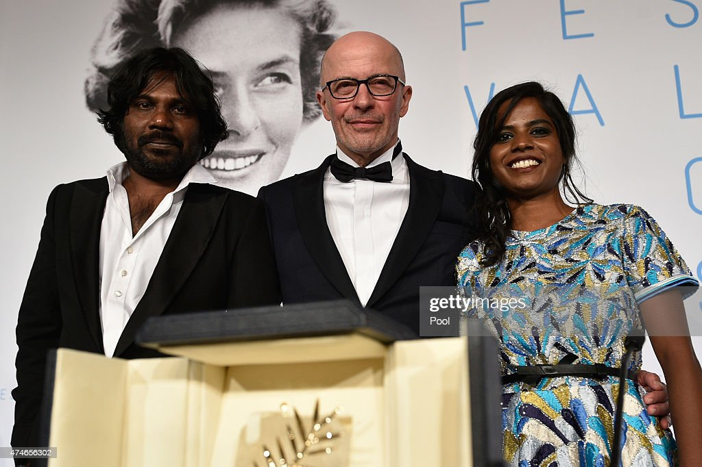 Actor Jesuthasan Antonythasan director Jacques Audiard and actress Kalieaswari Srinivasan pose with Palme d'Or won for 'Dheepan' during the Palme...