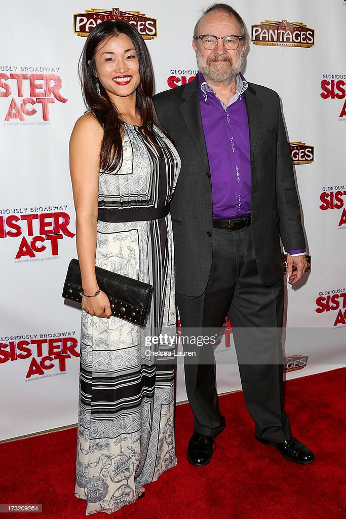 Actor Jim Beaver (R) arrives at the 'Sister Act' opening night premiere at the Pantages Theatre on July 9, 2013 in Hollywood, California.