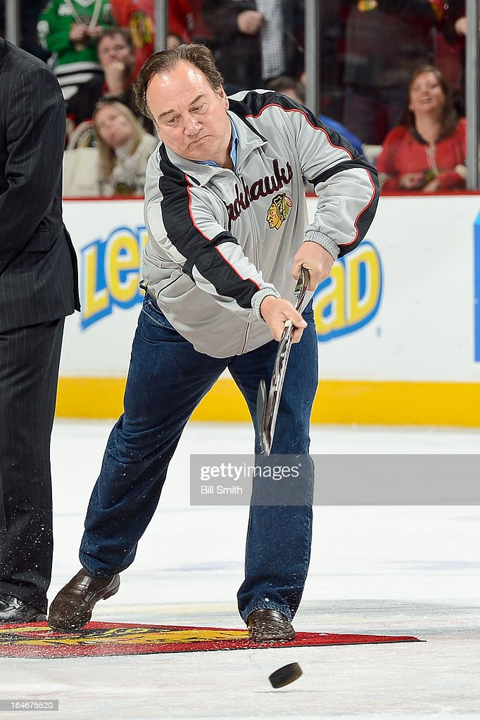 Actor <a gi-track='captionPersonalityLinkClicked' href=/galleries/search?phrase=Jim+Belushi&family=editorial&specificpeople=215411 ng-click='$event.stopPropagation()'>Jim Belushi</a> shoots the puck in between periods of the NHL game between the Los Angeles Kings and the Chicago Blackhawks on March 25, 2013 at the United Center in Chicago, Illinois.