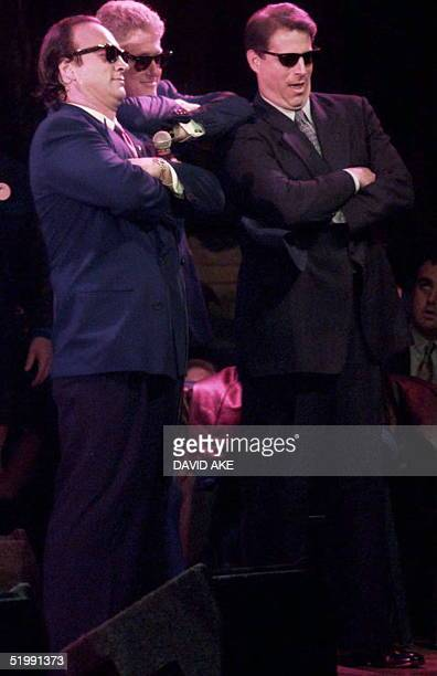 US actor Jim Belushi US President Bill Clinton and Vice President Al Gore do their imitation of the 'Blues Brothers' during a fund raising event at...