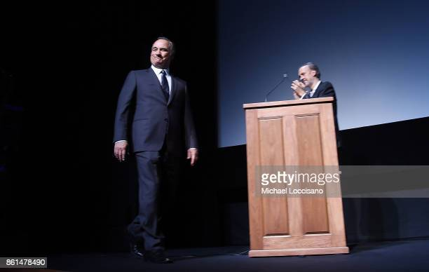 Actor Jim Belushi walks on stage while New York Film Festival Director Kent Jones introduces the screening of 'Wonder Wheel' during the closing night...