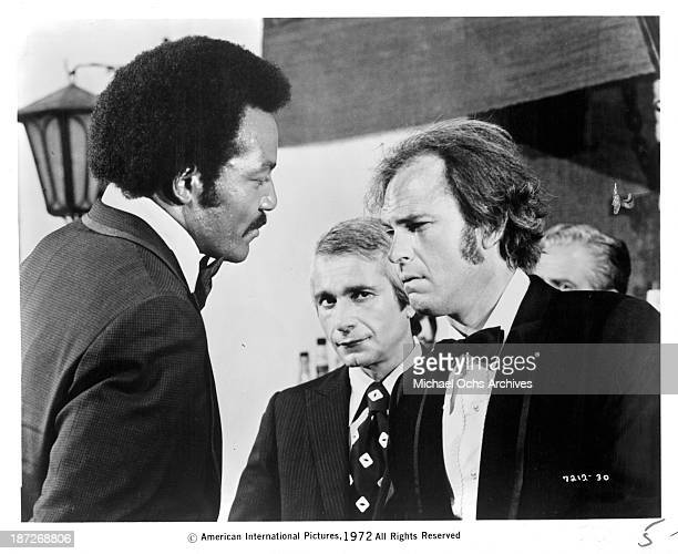 Actor Jim Brown and Rip Torn on the set of the movie 'Slaughter' in 1972