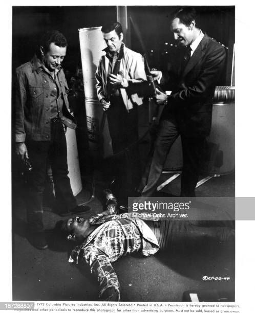 Actor Jim Brown Martin Landau and William Campbell on set of the Columbia Pictures movie 'Black Gunn' in 1972