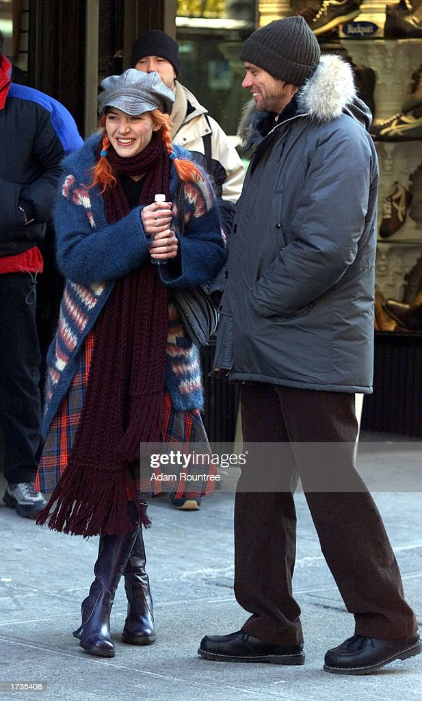 Actor Jim Carrey (R) and actress Kate Winslet stand on the movie set of 'Eternal Sunshine of the Spotless Mind' January 20, 2003 in New York City.