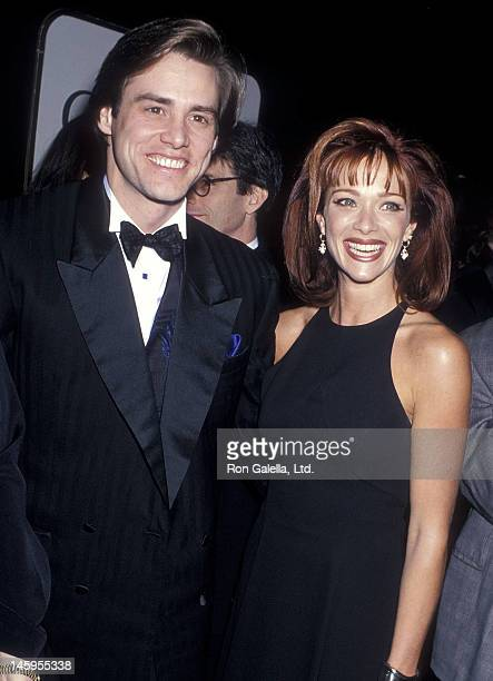 Actor Jim Carrey and actress Lauren Holly attend the 52nd Annual Golden Globe Awards on January 21 1995 at the Beverly Hilton Hotel in Beverly Hills...