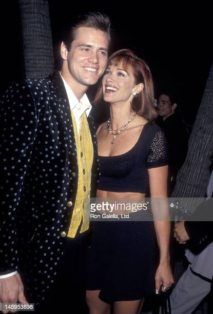 Actor Jim Carrey and actress Lauren Holly attend 'The Mask' Beverly Hills Premiere on July 28 1994 at the Academy Theatre in Beverly Hills California