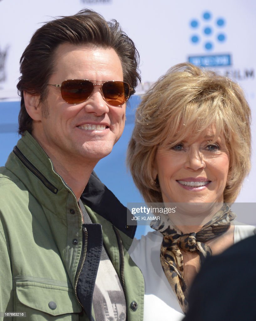 Actor Jim Carrey (L) attends actress Jane Fonda's (R) Handprint/Footprint Ceremony during the 2013 TCM Classic Film Festival at TCL Chinese Theatre on April 27, 2013 in Los Angeles. Fonda is an American actress, writer, political activist, former fashion model, and fitness guru. She rose to fame in the 1960s with films such as Barbarella and Cat Ballou. She has won two Academy Awards, an Emmy Award, three Golden Globes and received several other movie awards and nominations during more than 50 years as an actress. After 15 years of retirement, she returned to film in 2005 with Monster-in-Law, followed by Georgia Rule two years later. She also produced and starred in over 20 exercise videos released between 1982 and 1995, and once again in 2010. AFP PHOTO/JOE KLAMAR