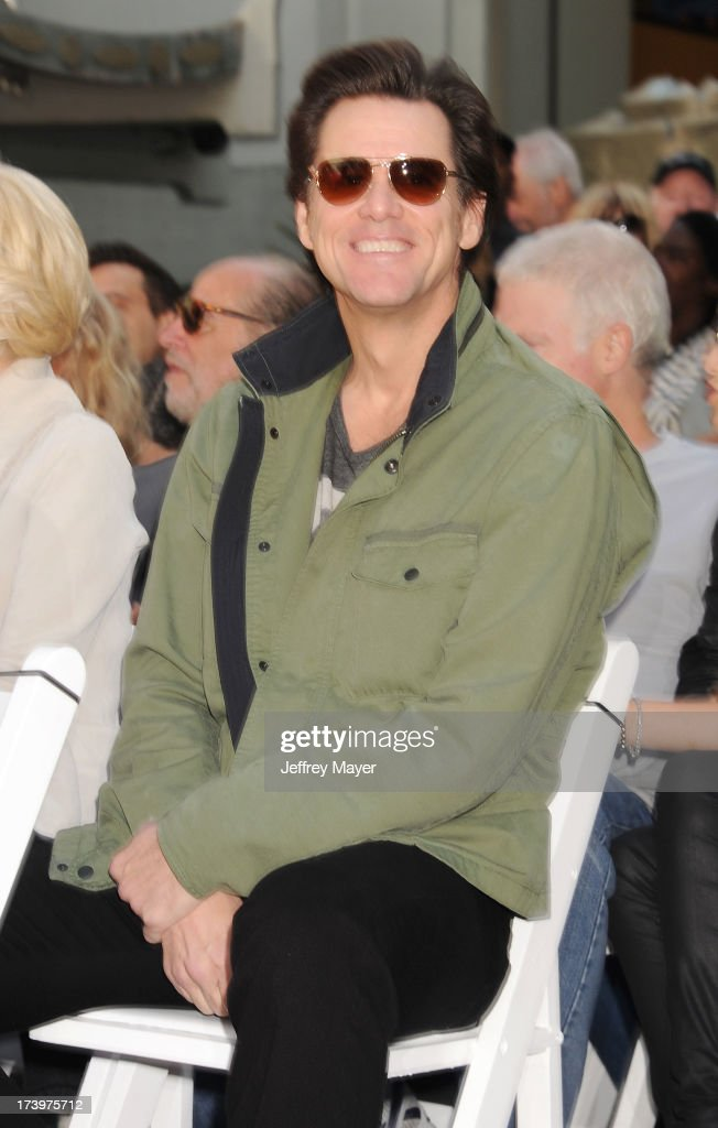 Actor Jim Carrey attends actress Jane Fonda's Handprint/Footprint Ceremony during the 2013 TCM Classic Film Festival at TCL Chinese Theatre on April 27, 2013 in Los Angeles, California.