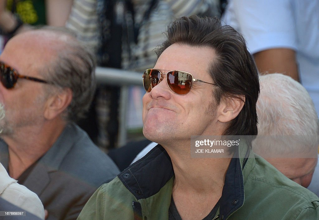 Actor Jim Carrey attends Jane Fonda's Handprint/Footprint Ceremony during the 2013 TCM Classic Film Festival at TCL Chinese Theatre on April 27, 2013 in Los Angeles. Fonda is an American actress, writer, political activist, former fashion model, and fitness guru. She rose to fame in the 1960s with films such as Barbarella and Cat Ballou. She has won two Academy Awards, an Emmy Award, three Golden Globes and received several other movie awards and nominations during more than 50 years as an actress. After 15 years of retirement, she returned to film in 2005 with Monster-in-Law, followed by Georgia Rule two years later. She also produced and starred in over 20 exercise videos released between 1982 and 1995, and once again in 2010. AFP PHOTO/JOE KLAMAR