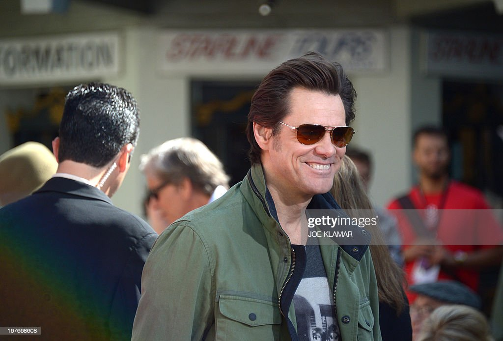 Actor Jim Carrey attends Jane Fonda's Handprint/Footprint Ceremony during the 2013 TCM Classic Film Festival at TCL Chinese Theatre on April 27, 2013 in Los Angeles. Fonda is an American actress, writer, political activist, former fashion model, and fitness guru. She rose to fame in the 1960s with films such as Barbarella and Cat Ballou. She has won two Academy Awards, an Emmy Award, three Golden Globes and received several other movie awards and nominations during more than 50 years as an actress. After 15 years of retirement, she returned to film in 2005 with Monster-in-Law, followed by Georgia Rule two years later. She also produced and starred in over 20 exercise videos released between 1982 and 1995, and once again in 2010.