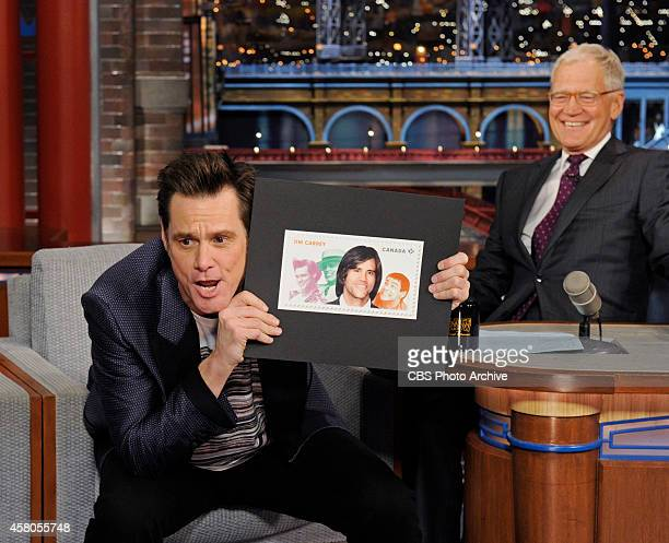 Actor Jim Carrey shows off his new stamp on the Late Show with David Letterman Wednesday Oct 29 2014 on the CBS Television Network