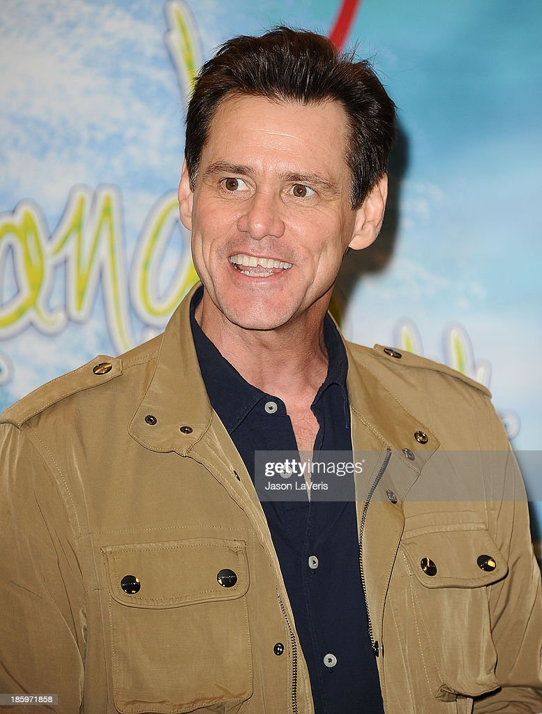 Actor <a gi-track='captionPersonalityLinkClicked' href=/galleries/search?phrase=Jim+Carrey&family=editorial&specificpeople=171515 ng-click='$event.stopPropagation()'>Jim Carrey</a> signs copies of his new children's book 'How Roland Rolls' at Barnes & Noble bookstore at The Grove on October 26, 2013 in Los Angeles, California.