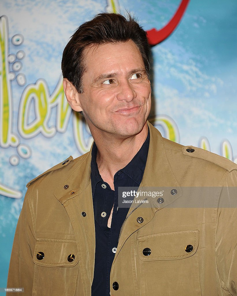 Actor Jim Carrey signs copies of his new children's book 'How Roland Rolls' at Barnes & Noble bookstore at The Grove on October 26, 2013 in Los Angeles, California.