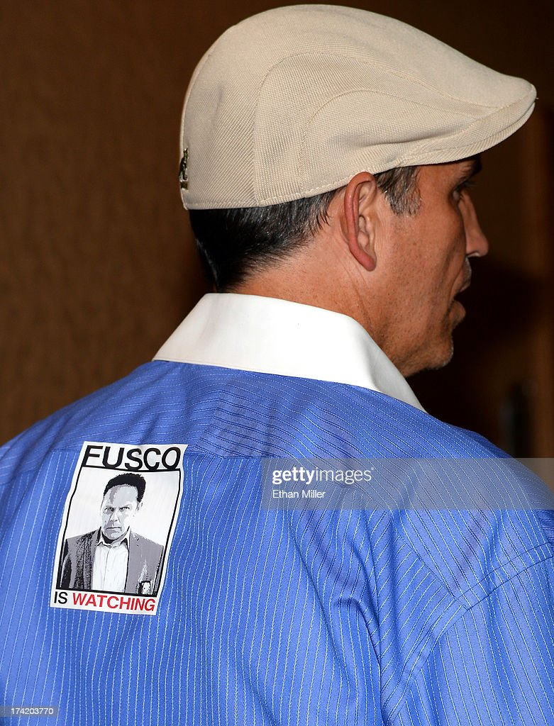 Actor Jim Caviezel wears an image of actor Kevin Chapman's character Lionel Fusco at the 'Person of Interest' press line during Comic-Con International 2013 at the Hilton San Diego Bayfront Hotel on July 20, 2013 in San Diego, California.