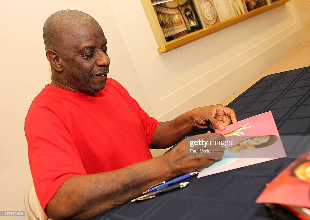 Actor <a gi-track='captionPersonalityLinkClicked' href=/galleries/search?phrase=Jimmie+Walker+-+Actor&family=editorial&specificpeople=650111 ng-click='$event.stopPropagation()'>Jimmie Walker</a> signs a copy of his book 'Dynomite! Good Times, Bad Times, Our Times - A Memoir' at the McGowan Theater on May 3, 2013 in Washington, DC.