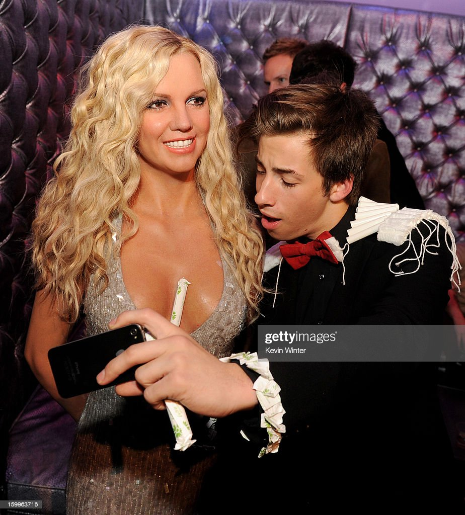 Actor Jimmy Bennett poses with a wax figure of <a gi-track='captionPersonalityLinkClicked' href=/galleries/search?phrase=Britney+Spears&family=editorial&specificpeople=156415 ng-click='$event.stopPropagation()'>Britney Spears</a> at the after party for the premiere of Relativity Media's 'Movie 43' at Madame Tussaud's Hollywood on January 23, 2013 in Los Angeles, California.