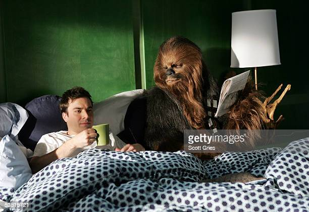 Actor Jimmy Fallon lies in bed with Chewbacca during filming for a promo for the 2005 MTV Movie Awards at Paris Studios May 12 2005 in Queens borough...
