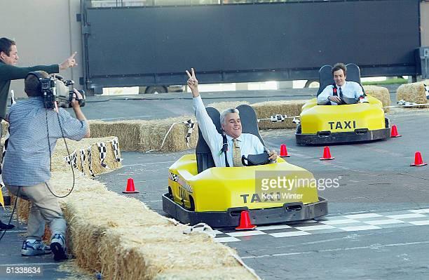 Actor Jimmy Fallon races Jay Leno on 'The Tonight Show with Jay Leno' at the NBC Studios on September 22 2004 in Burbank California
