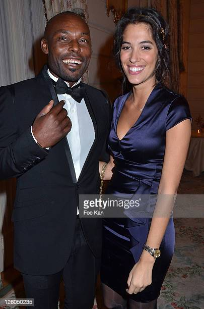 Actor Jimmy Jean Louis and TV presenter Laurie Cholewa attend the 'European Time For Peace Awards' at the Hotel Ritz on December 10 2010 in Paris...