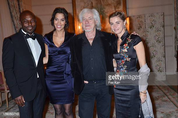 Actor Jimmy Jean Louis TV presenter Laurie Cholewa singer Hugues Aufray and actress Anne Consigny attend the 'European Time For Peace Awards' at the...