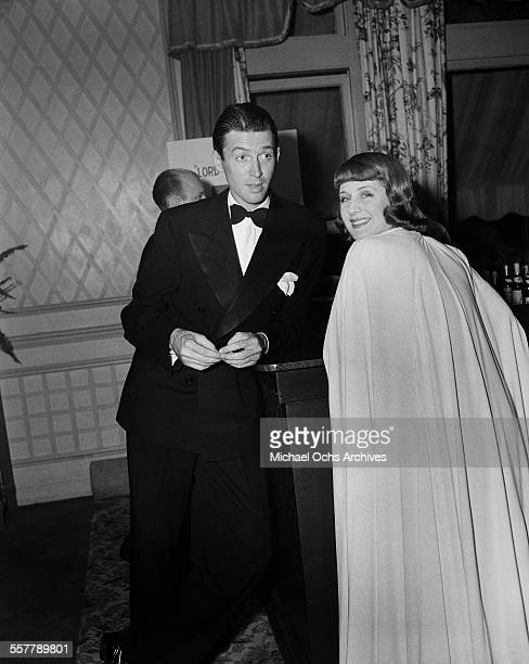 Actor Jimmy Stewart stands with actress Norma Shearer during an event in Los Angeles California