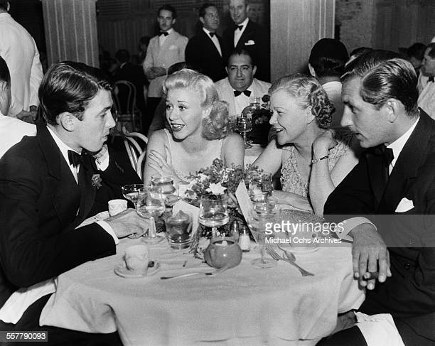 Actor Jimmy Stewart with actress Ginger Rogers her mother Lela Rogers and husband actor Lew Ayres have dinner as actor Cecil Kellaway dines in the...