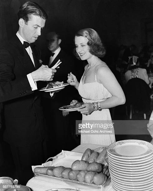 Actor Jimmy Stewart with actress Norma Shearer during an event in Los Angeles California