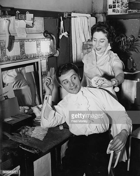 Actor Jimmy Thompson being assisted by his wife Nina Binckley as he gets ready in his dressing room for his role as 'Liberace' at the Apollo Theatre...