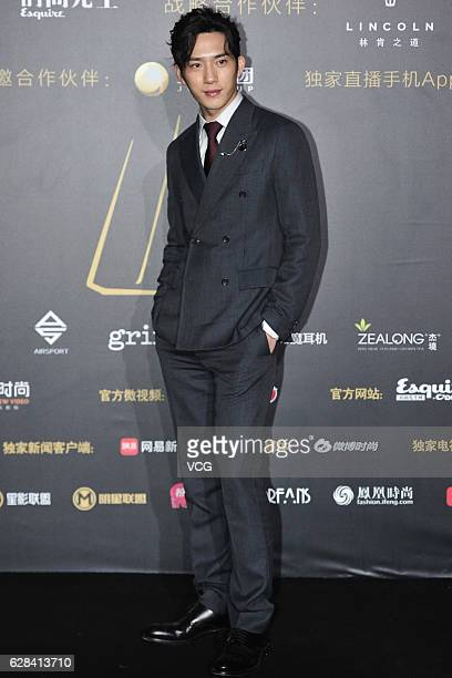 Actor Jing Boran poses on the red carpet of the 13th Man At His Best Award at the Worker's Stadium on December 7 2016 in Beijing China