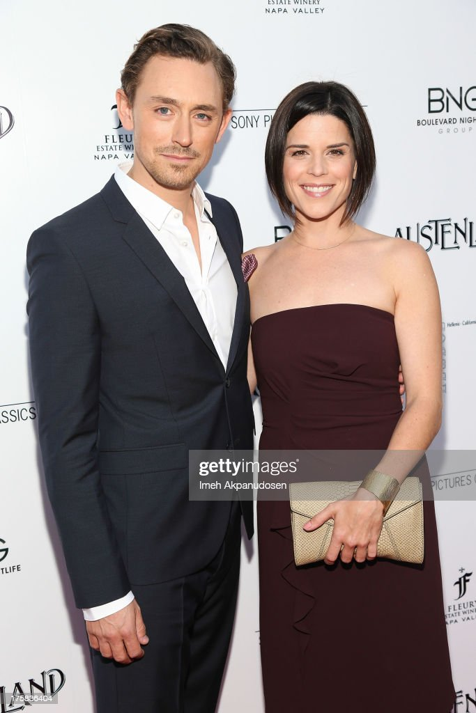 Actor J.J. Feild (L) and actress <a gi-track='captionPersonalityLinkClicked' href=/galleries/search?phrase=Neve+Campbell&family=editorial&specificpeople=202239 ng-click='$event.stopPropagation()'>Neve Campbell</a> attend the premiere of Sony Pictures Classics' 'Austenland' at ArcLight Hollywood on August 8, 2013 in Hollywood, California.