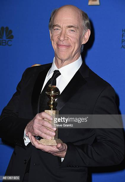 Actor JK Simmons poses in the press room during the 72nd Annual Golden Globe Awards at The Beverly Hilton Hotel on January 11 2015 in Beverly Hills...