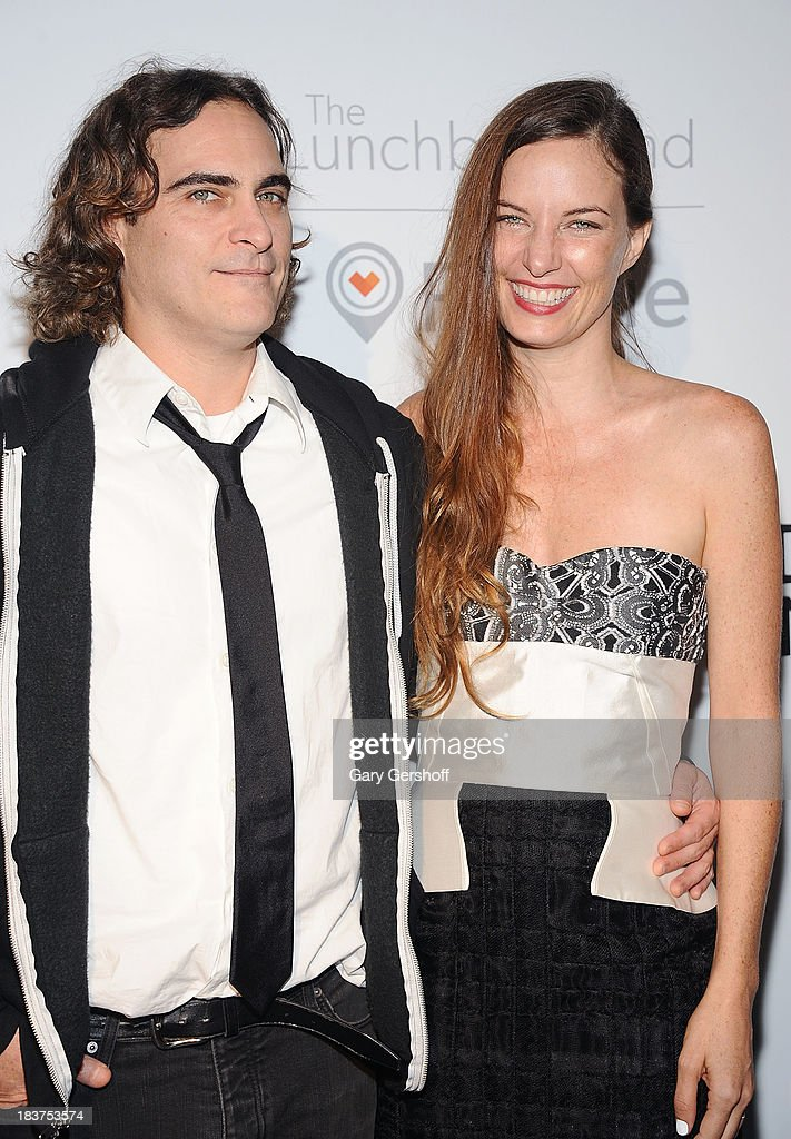 Actor Joaquin Phoenix (L) and Founder and Executive Director of The Lunchbox Fund Topaz Page-Green attend the Lunchbox Fund Fall Fete 2013 at Buddakan on October 9, 2013 in New York City.