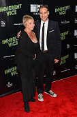 Actor Joaquin Phoenix and publicist Susan Patricola attend the Centerpiece Gala Presentation and World Premiere of 'Inherent Vice' during the 52nd...