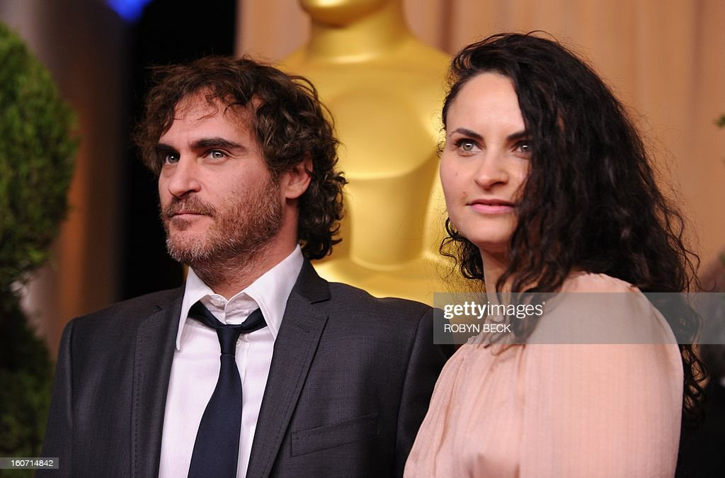 Actor Joaquin Phoenix and Rain Phoenix attend the 85th Academy Awards Nominees Luncheon at The Beverly Hilton Hotel on February 4, 2013 in Beverly Hills, California. AFP PHOTO / Robyn Beck