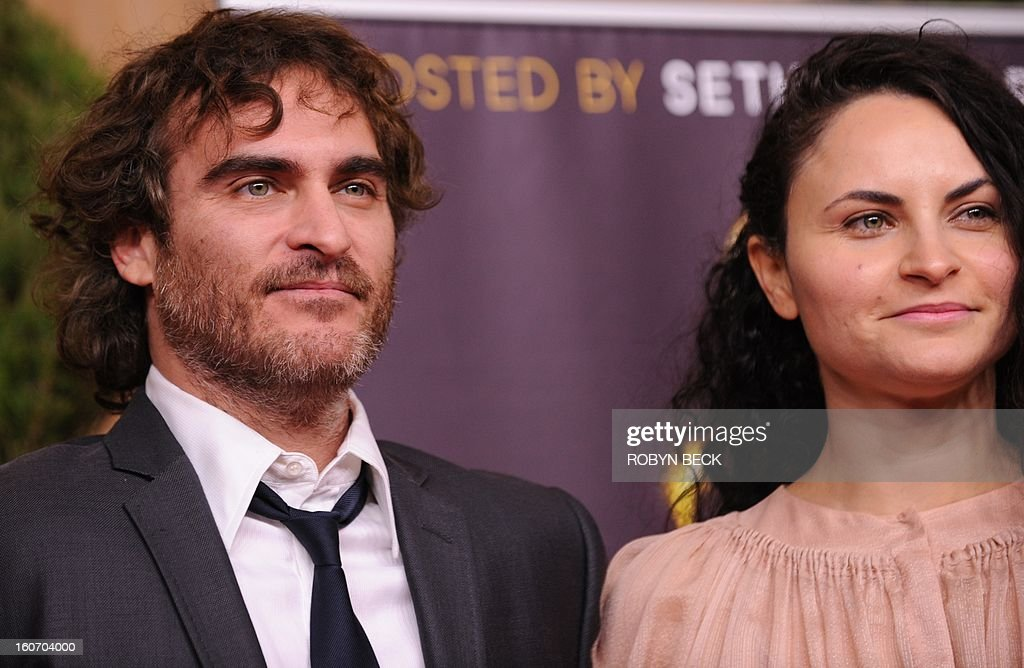Actor Joaquin Phoenix and Rain Phoenix (R) the 85th Academy Awards Nominees Luncheon at The Beverly Hilton Hotel on February 4, 2013 in Beverly Hills, California. AFP PHOTO / Robyn Beck