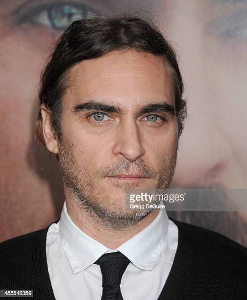 Actor Joaquin Phoenix arrives at the Los Angeles premiere of 'Her' at Directors Guild Of America on December 12 2013 in Los Angeles California