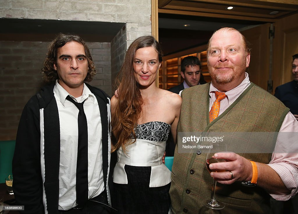 Actor Joaquin Phoenix, Founder and Executive Director of The Lunchbox Fund Topaz Page-Green and Mario Batali attend The Lunchbox Fund Fall Fête at Buddakan, New York on October 9, 2013 in New York City.