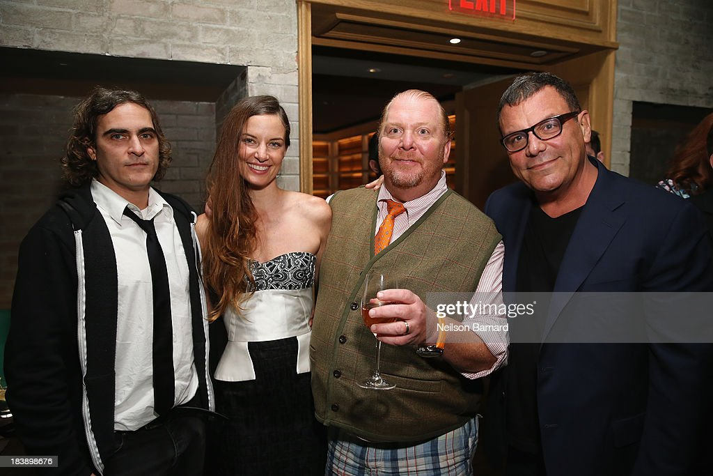 Actor Joaquin Phoenix, Founder and Executive Director of The Lunchbox Fund Topaz Page-Green, Mario Batali and owner of Buddakan Stephen Starr and Founder and Executive Director of The Lunchbox Fund Topaz Page-Green attend The Lunchbox Fund Fall Fête at Buddakan, New York on October 9, 2013 in New York City.