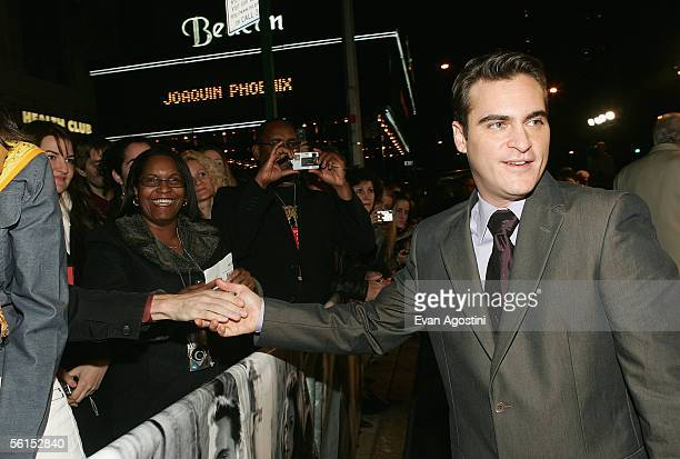 Actor Joaquin Phoenix greets fans at the premiere of 'Walk The Line' at the Beacon Theater November 13 2005 in New York City
