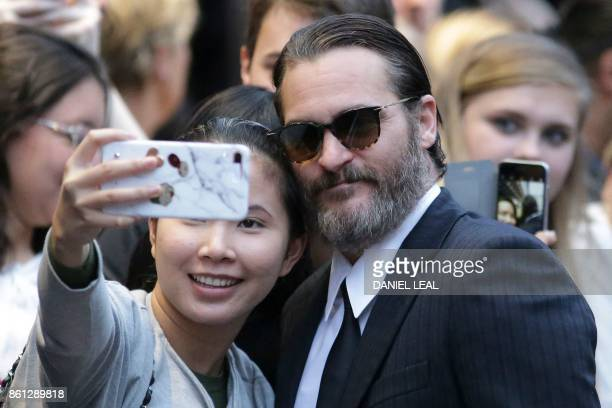 US actor Joaquin Phoenix poses for selfies with fans on the red carpet arriving for the gala screening of the film 'You were Never really Here'...