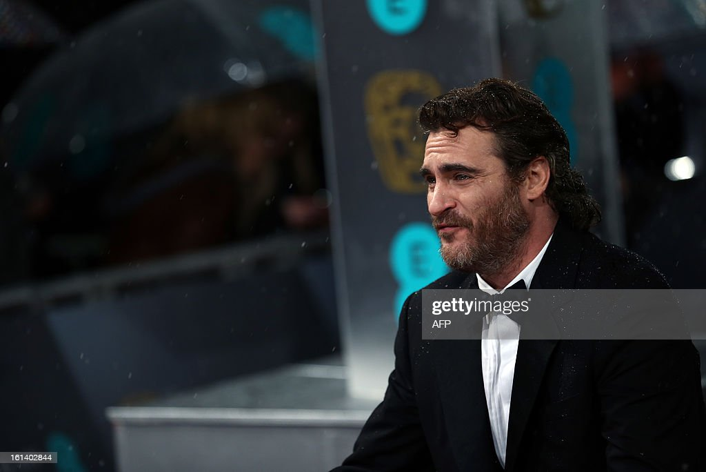 US actor Joaquin Phoenix poses on the red carpet upon arrival to attend the annual BAFTA British Academy Film Awards at the Royal Opera House in London on February 10, 2013.