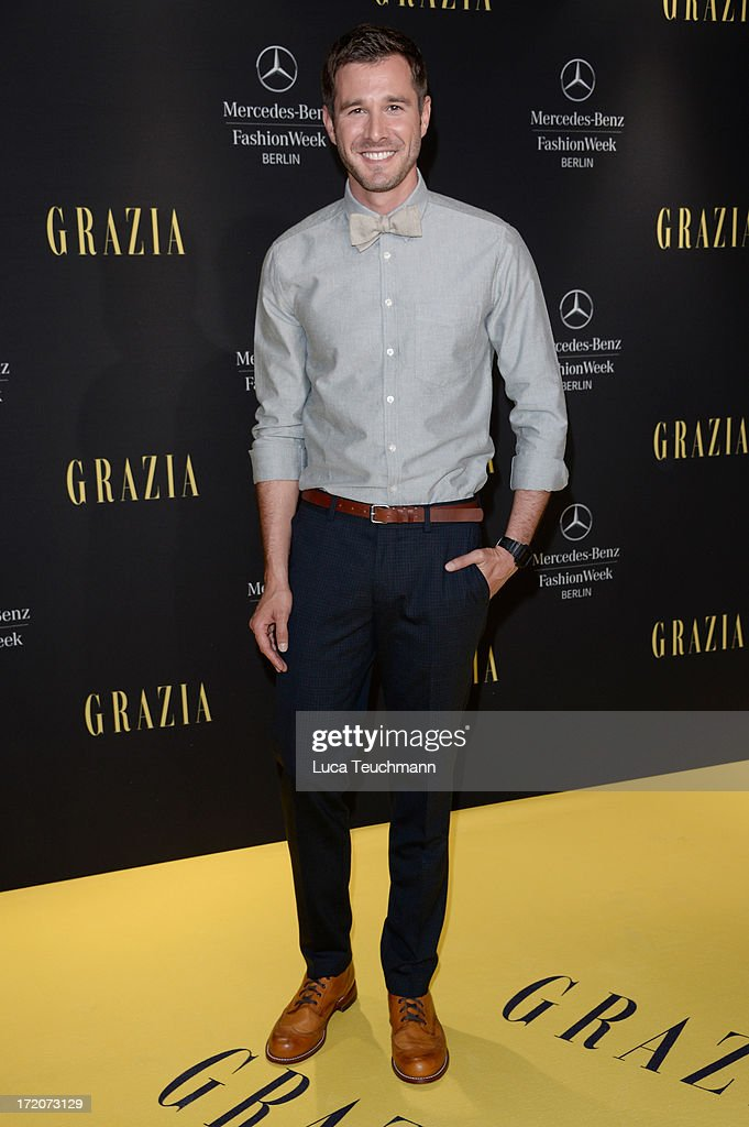 Actor Jochen Schropp attends the Mercedes-Benz Fashion Week Berlin Spring/Summer 2014 Preview Show by Grazia at the Brandenburg Gate on July 1, 2013 in Berlin, Germany.