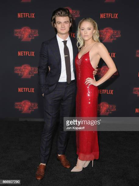 Actor Joe Keery and Maika Monroe arrive at the premiere of Netflix's 'Stranger Things' Season 2 at Regency Bruin Theatre on October 26 2017 in Los...