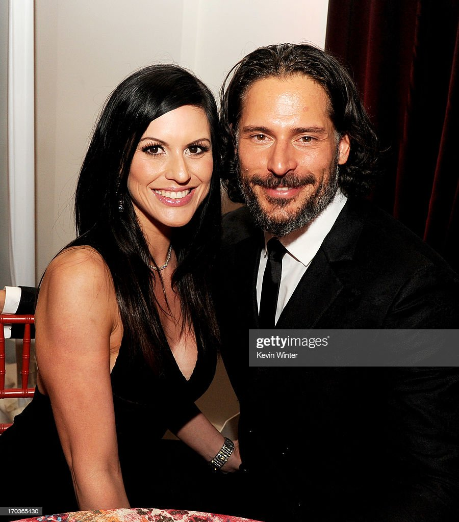 Actor <a gi-track='captionPersonalityLinkClicked' href=/galleries/search?phrase=Joe+Manganiello&family=editorial&specificpeople=2516889 ng-click='$event.stopPropagation()'>Joe Manganiello</a> (R) and Bridget Peters pose at the after party for the premiere of HBO's 'True Blood' at the Social Club on June 11, 2013 in Los Angeles, California.
